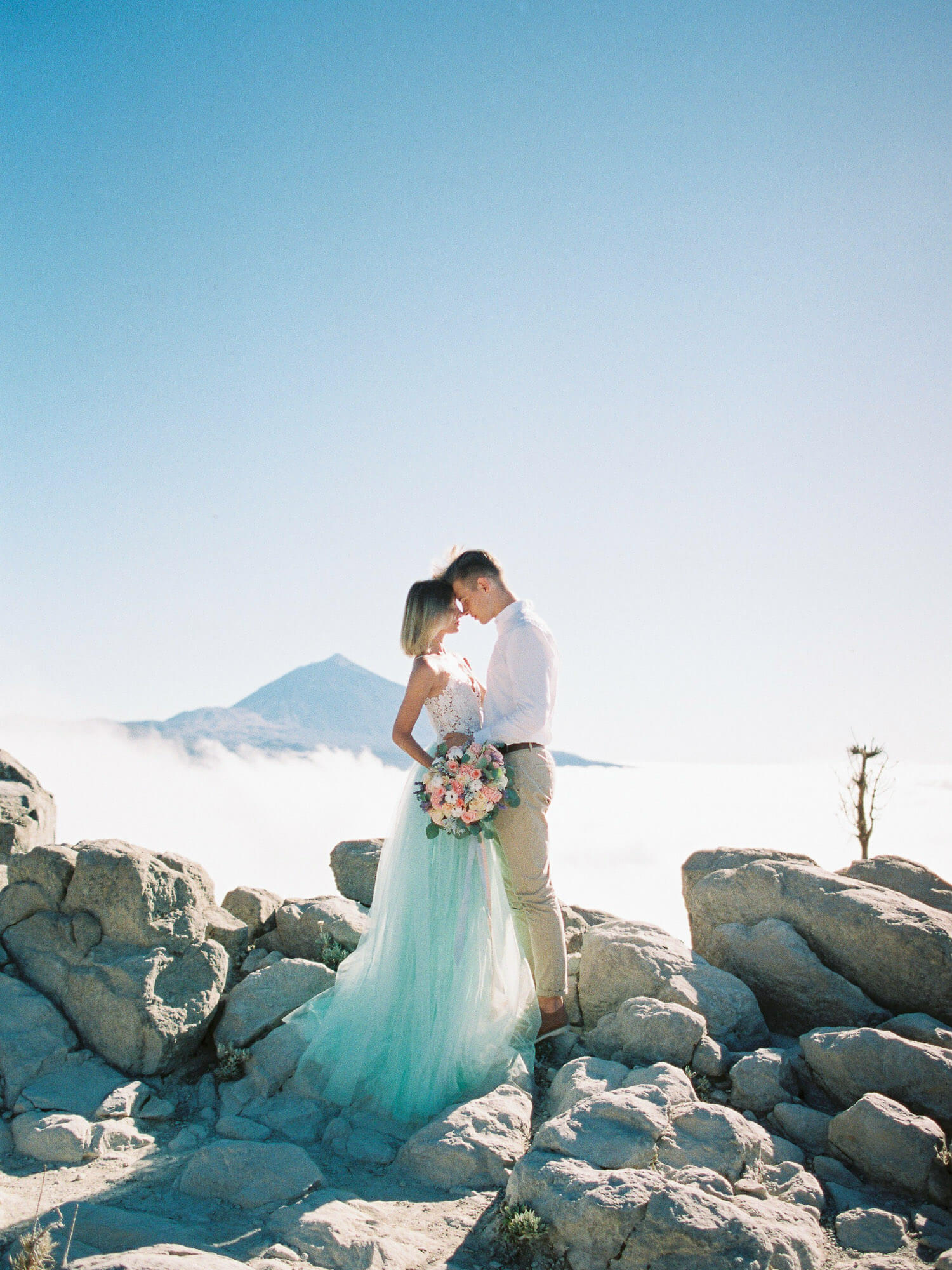 couple photoshoot above the clouds in Tenerife, volcano Teide