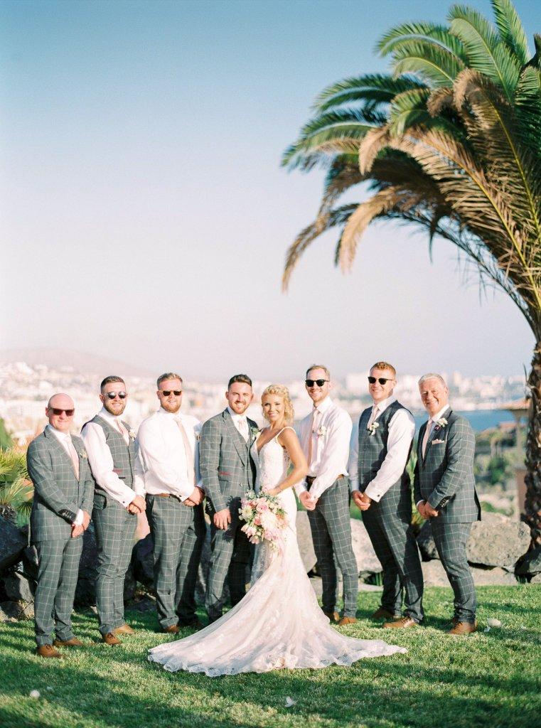 stylish bride groom with groomsmen